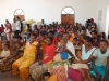 distribution-andranovory-with-people-waiting-in-church-march-22-2013