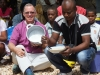 distribution-ankilifaly-for-ambohitsabo-bishop-todd-with-president-eating-rice