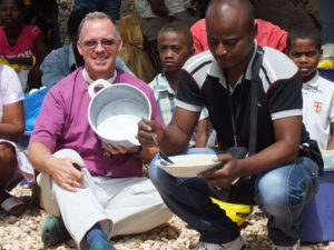 distribution ankilifaly for ambohitsabo Bishop Todd with President eating rice